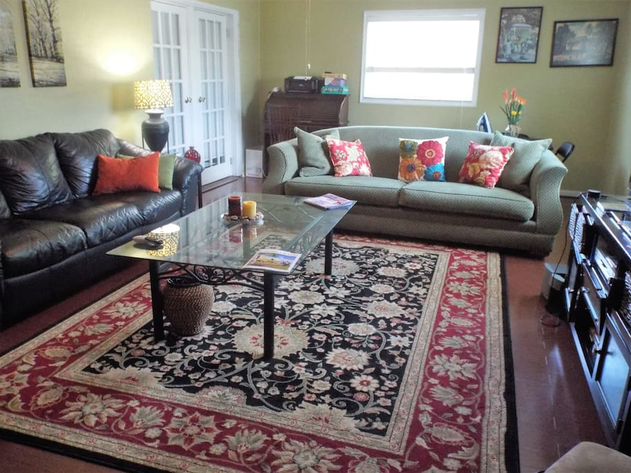 large family room with 2 large sofas,desk,game table,many games and 55'' TV