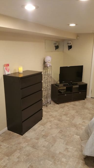 Main bedroom with dresser and T.V.