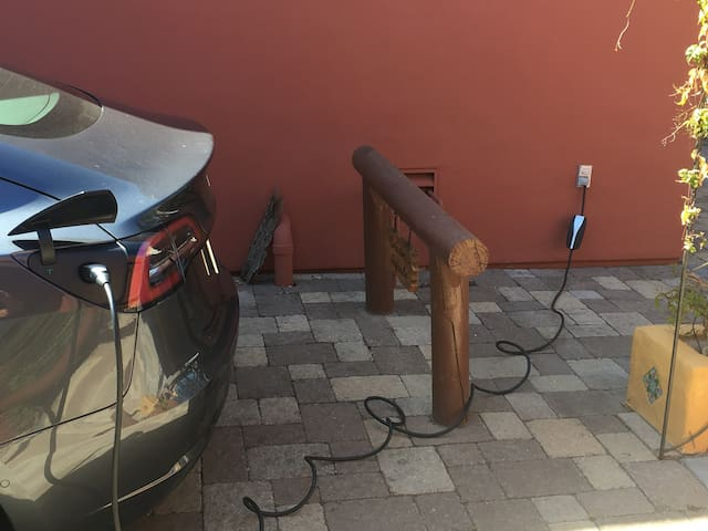 TESLA - ELECTRIC VEHICLES: We have an EV charging station! Happy Tesla guests say they get 5 miles p/charging hr (Additional fee of $12 p/day p/Electric Vehicle to use charging station; Please let us know you need EV station at time of booking)