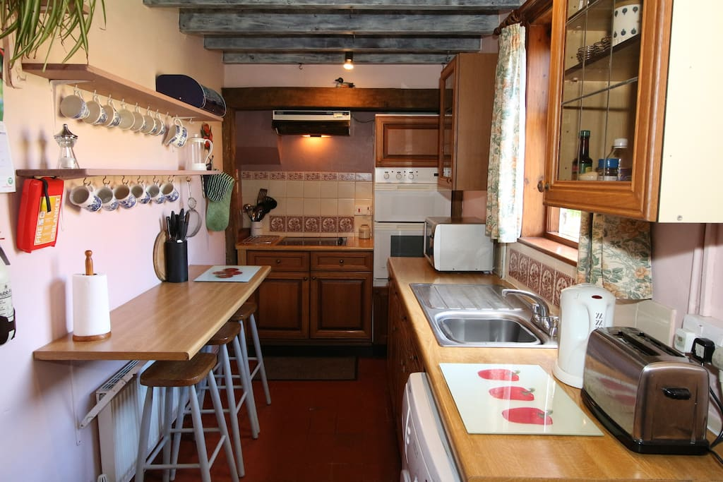Entering the cottage brings you into the kitchen