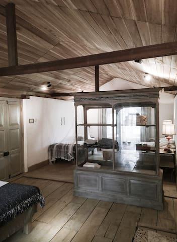 master bedroom suite with antique display cabinet
