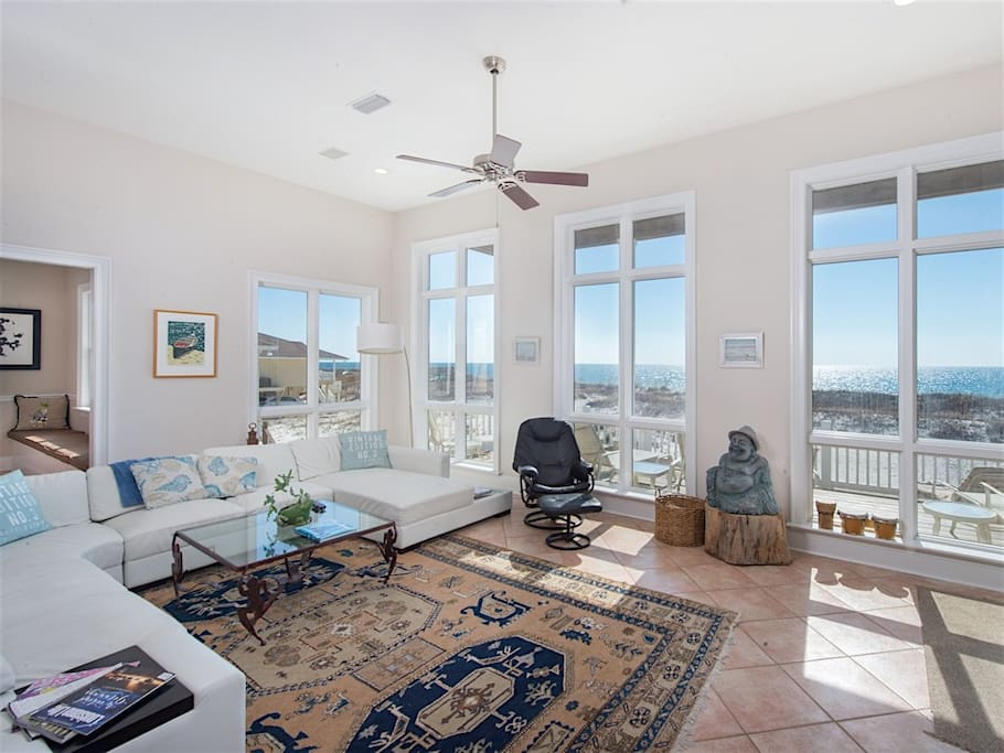 Enjoy the spectacular water views in the light filled living room.