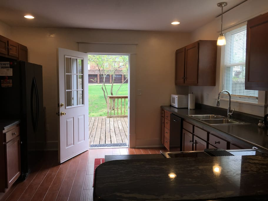 Large Fully Equipped Kitchen with door to Back Deck
