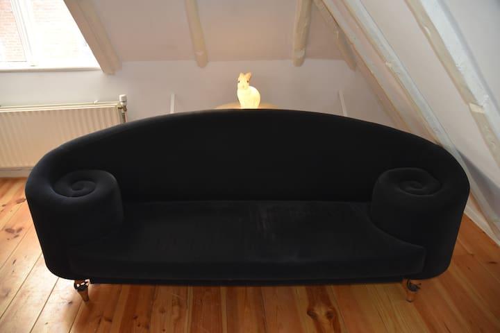 Our House Rabbit, behind the design sofa ( Maroeska Metz)