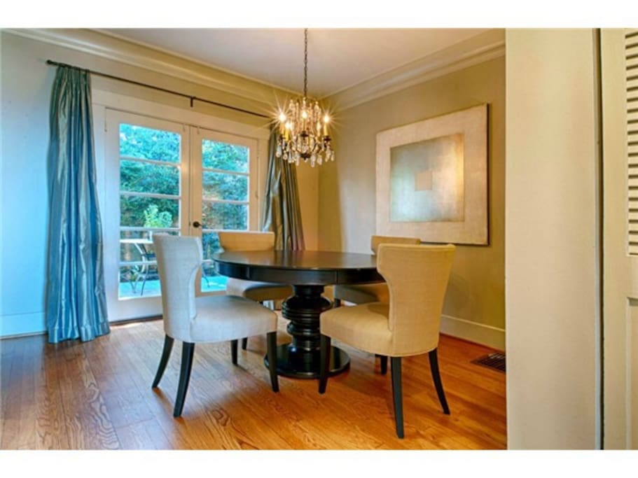 Dining room with French doors onto small back deck.