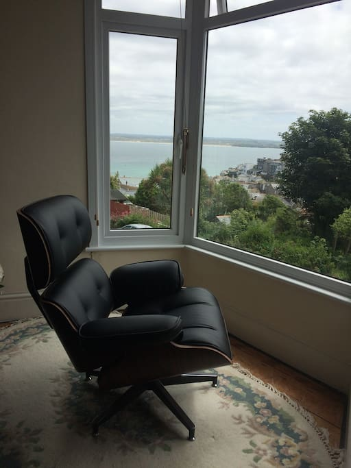 Relax in the Eames swivel chair and soak in the views...