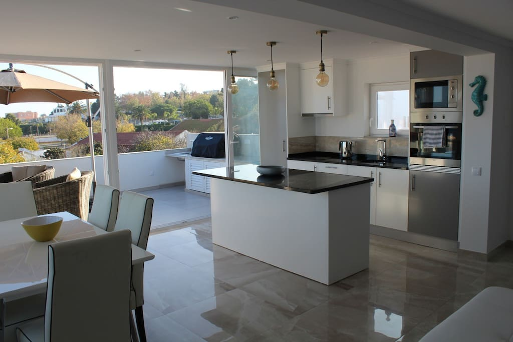 Fully equipped kitchen all doors open to the terrace and outdoor Kitchen