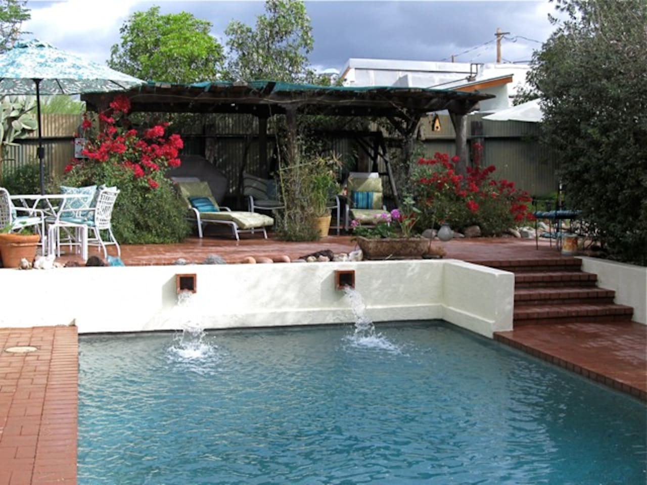 The pool and cabana area are just through the back gate and a wonderful, relaxing oasis. For Airbnb guests only, it's wonderfully relaxing and cool on a hot day. The Koi pond and waterfall is by the cabana as well.