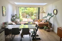 Open plan kitchen/dining and lounge in spacious plant filled garden
