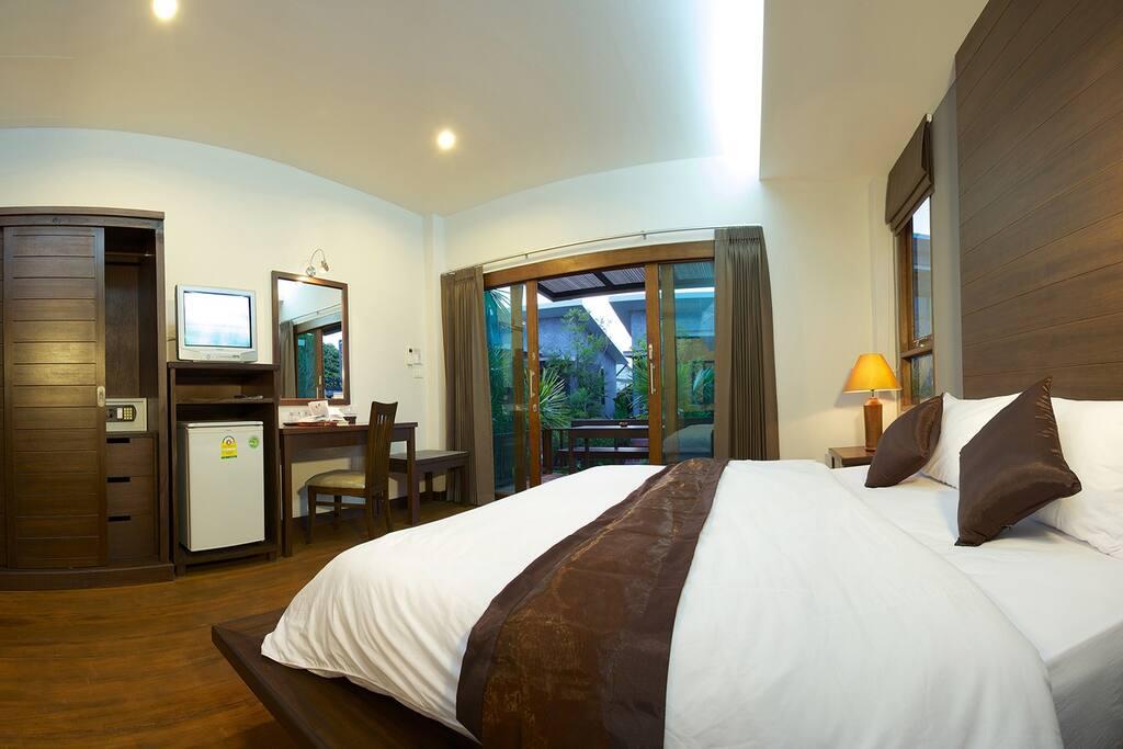room includes wardrobe, safe, fridge, kettle, desk and mirror