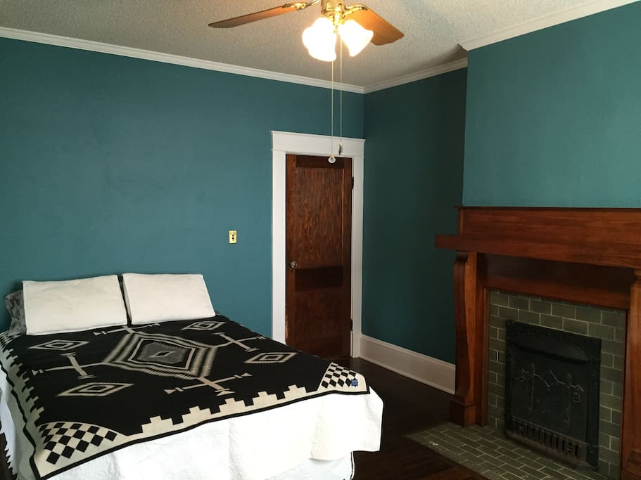 Queen bed and fireplace