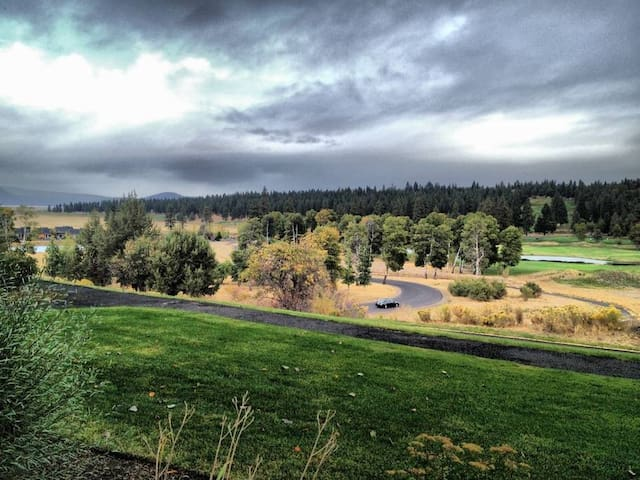Part of the 8 miles of paved trail in the foreground, with a portion of the golf course exposed in the background.