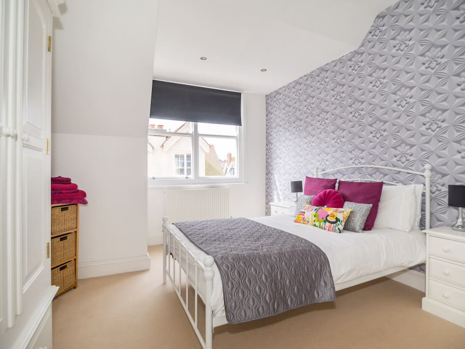 Stylish main bedroom with great storage and plenty of sun!