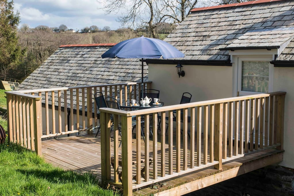 The room opens onto a decking area perfect for an alfresco breakfast.