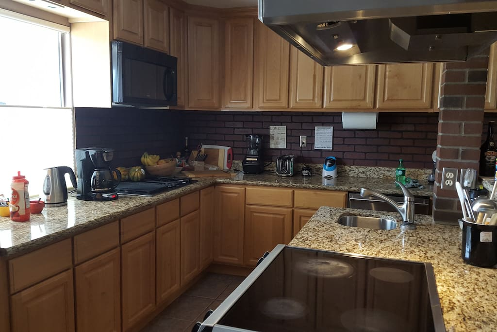 A Chefs Kitchen with granite counters and custom cabnets!