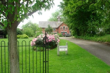 ** THE CARRIAGE HOUSE **