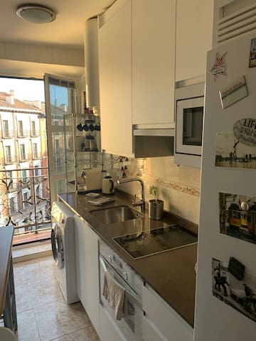 New light-filled kitchen with balcony