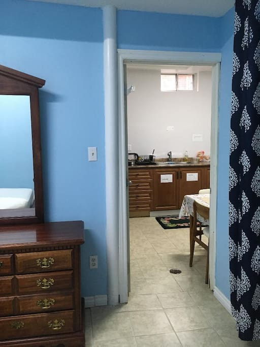 Bedroom doorway leading out into kitchenette.