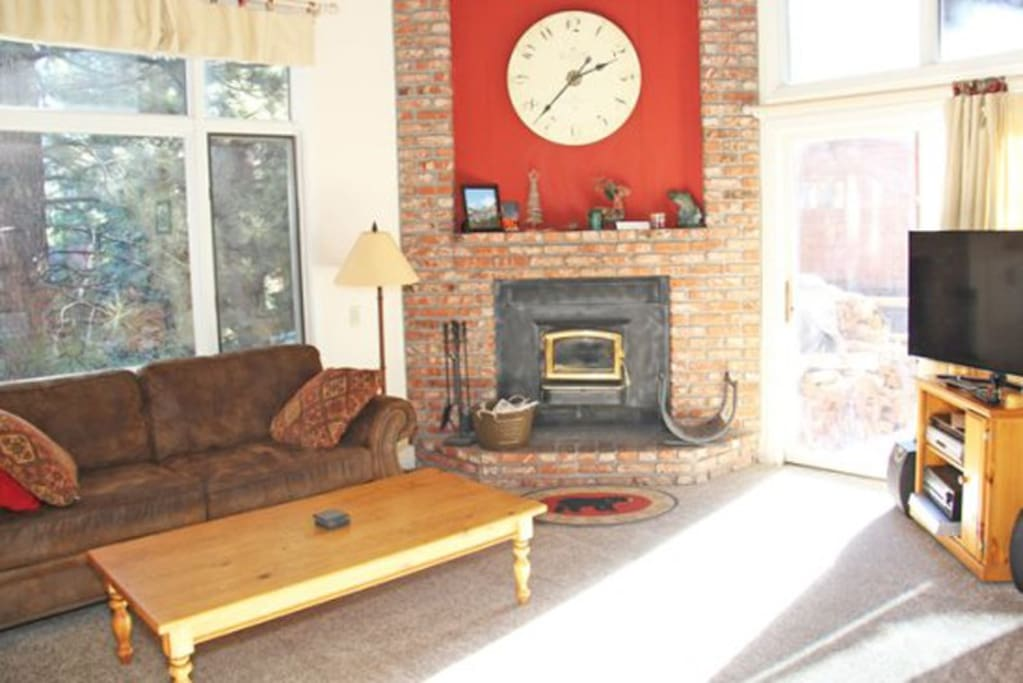 Mammoth Lakes Condo Rental Woodlands 28 - Living Room Opens to Deck on Sierra Star Golf Course