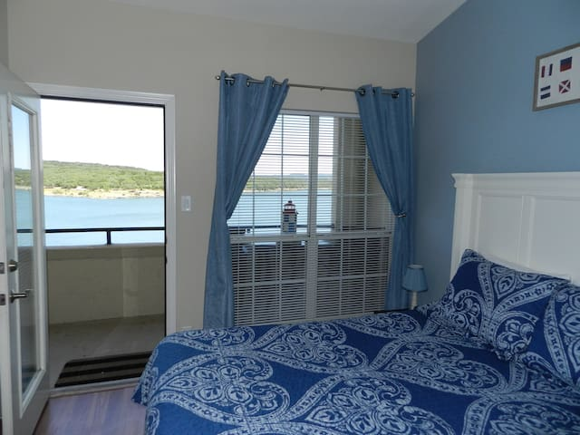 bedroom has great views of the lake