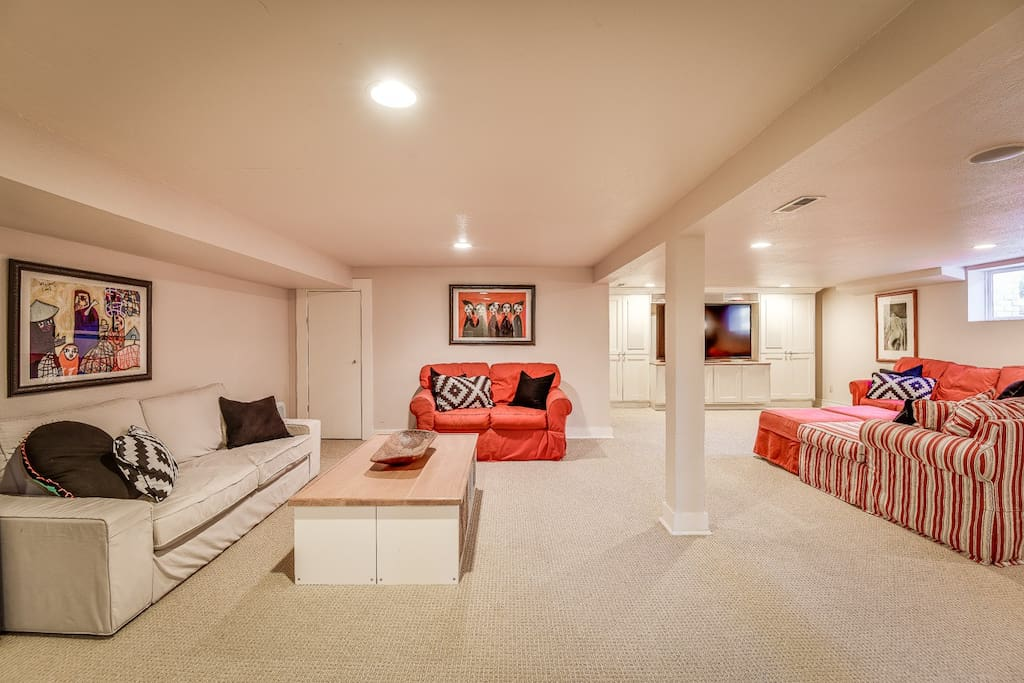 Light and Large private basement apartment.  Plenty of seating, pull out couch and chair and a half that is a perfect little bed for littles.
