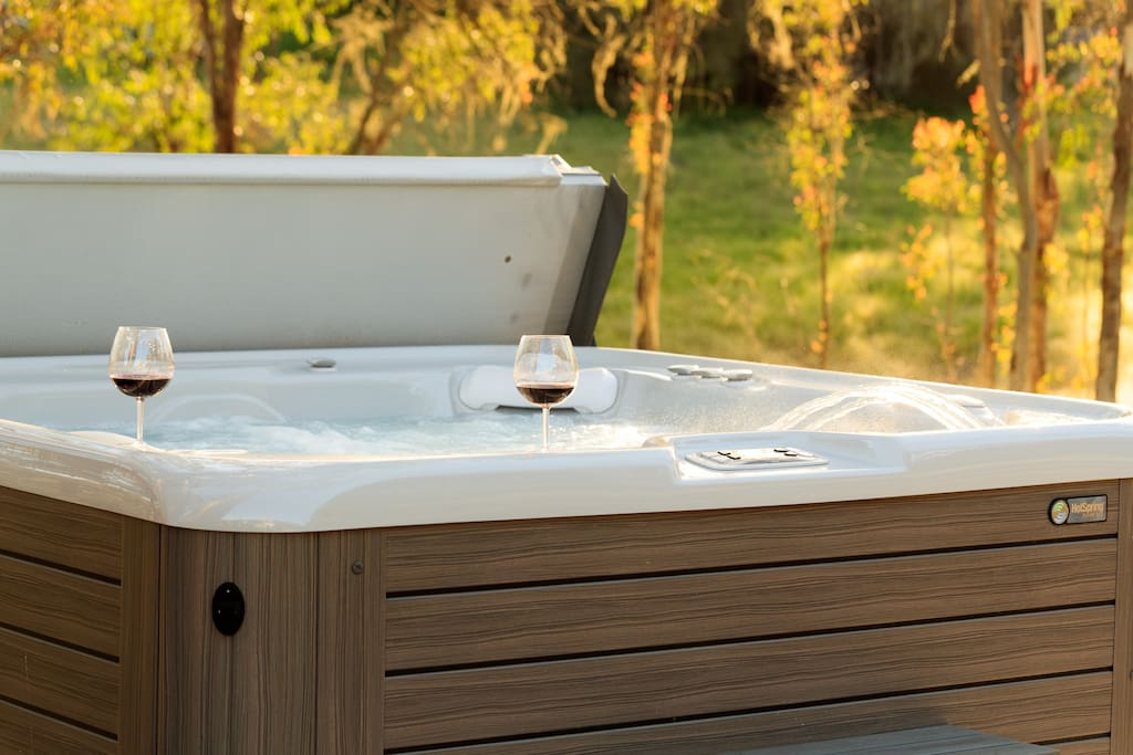The clean, well-maintained Hotspring Vanguard hot tub seats up to six people.