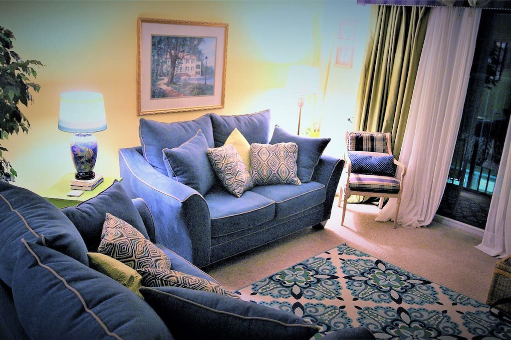 Comfy sofas and chairs make the living spaces warm and inviting.