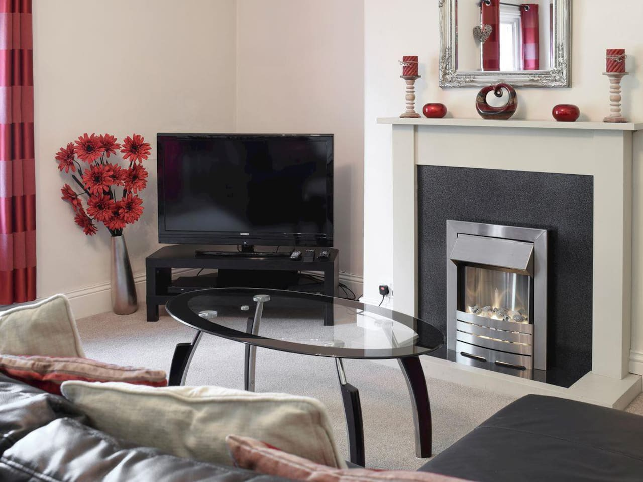Lounge with gas central heating and electric fire