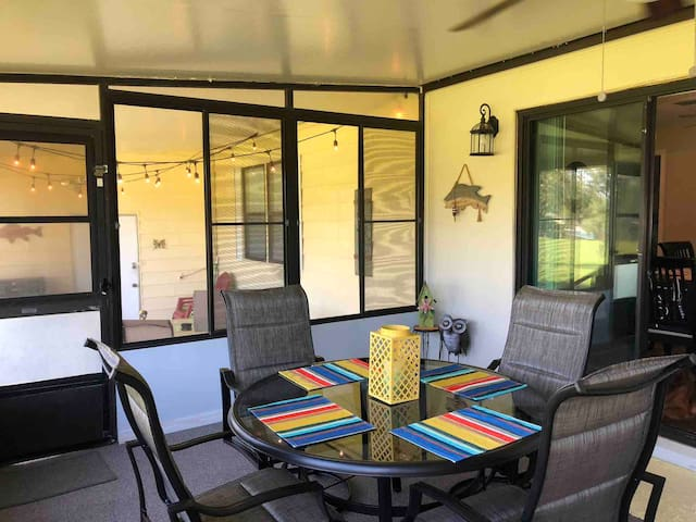 Dining area on Air conditioned back porch.