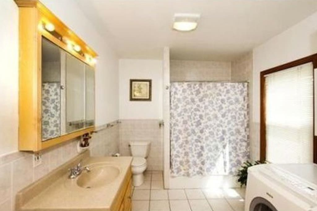 First floor bath with laundry room
