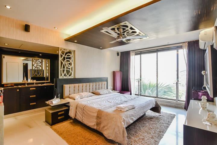 Comfortable bedroom in a Penthouse at Bandra West