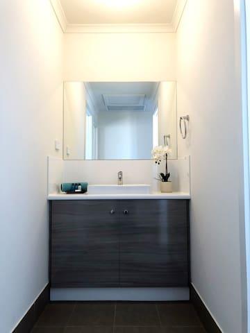 Bathroom One - three way bathroom with separate vanity, separate toilet and separate shower room.