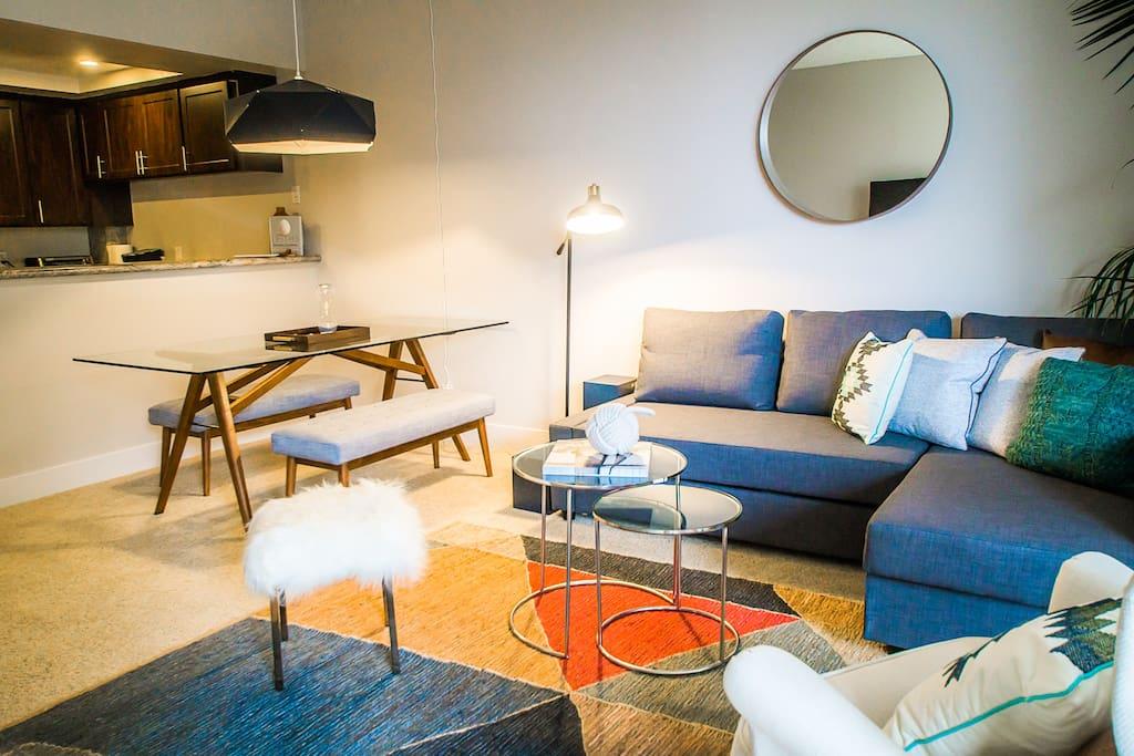 Open floor plan with full-size sleeper sofa