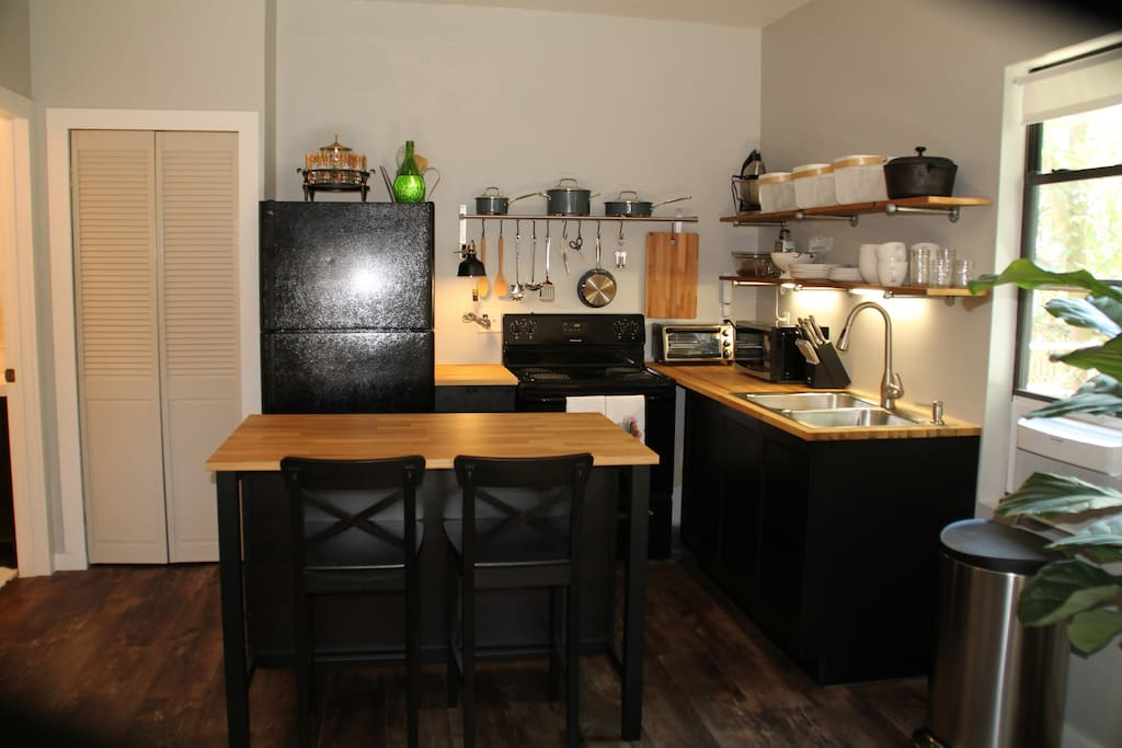fully stocked kitchen, cuisinart pots + pans, all you need to bring is the food.  bon appetit!