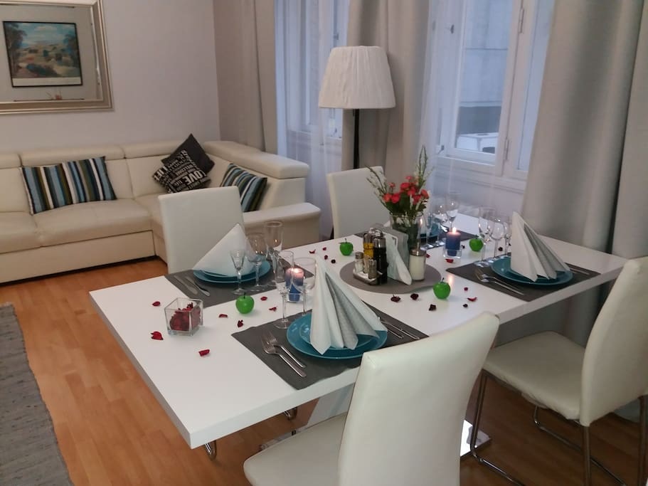 The living room is furnished with a comfortable pull-out sofa bed and cable TV, dining table for 8 person.