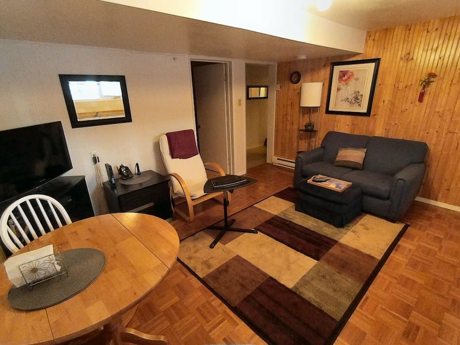Living room, with TV, loveseat, dining table, WiFi