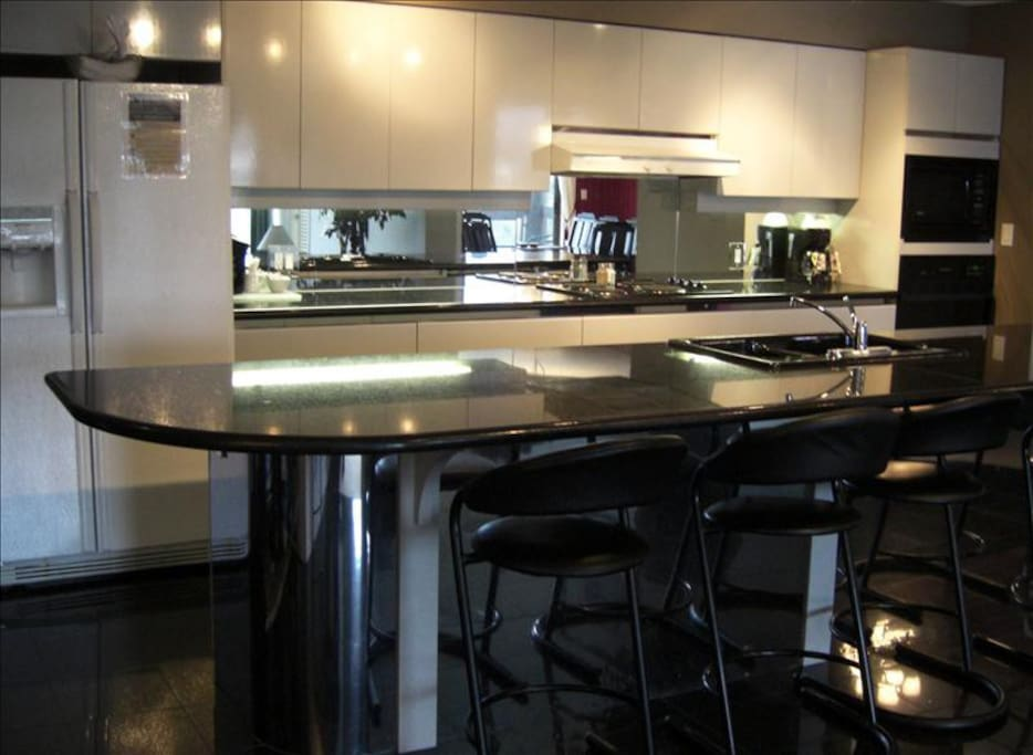 Modern fully-equipped kitchen with large granite island