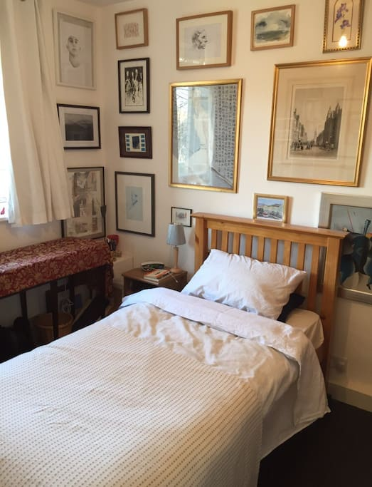 The guest bedroom. A comfortable single bed with a wardrobe. Many books and paintings. You are very welcome to use the rest of the apartment during your stay.