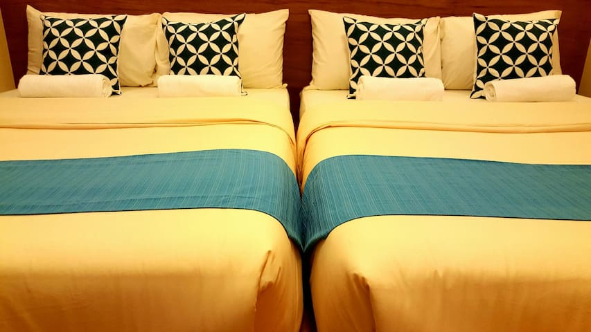 The 2 full beds may be joined together to form 1 big bed.