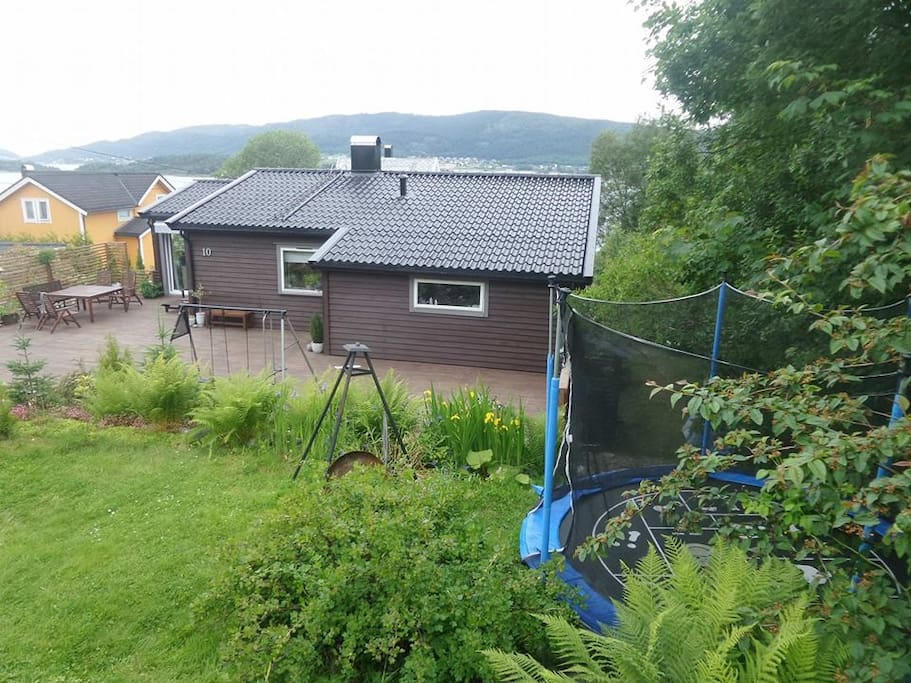 Our big garden has trampoline and small tree house for kid to play.