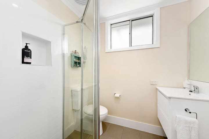 The en-suite is new bright and airy.