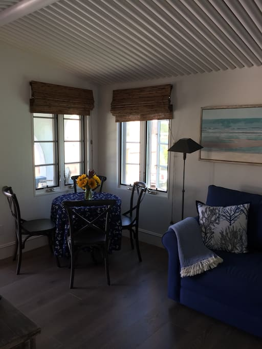 Dining area with seating for 4 and wonderful water/beach views