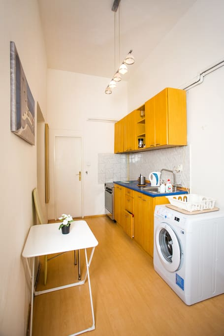 Shared kitchen with entrance to shared shower and toilet
