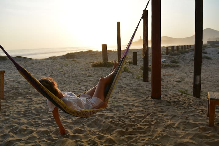 That view and a hammock: the perfect combo to watch the sunset from your beach home!