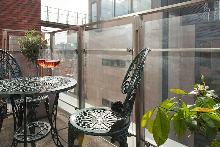 Balcony and furniture with view of private roof garden
