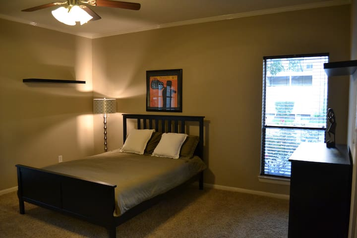 Large bedroom with his and her walk-in closet and two side natural light