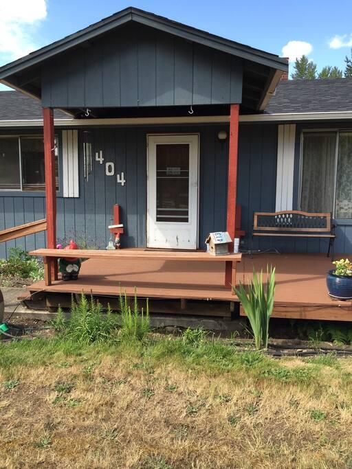 Front deck. Entry door.
