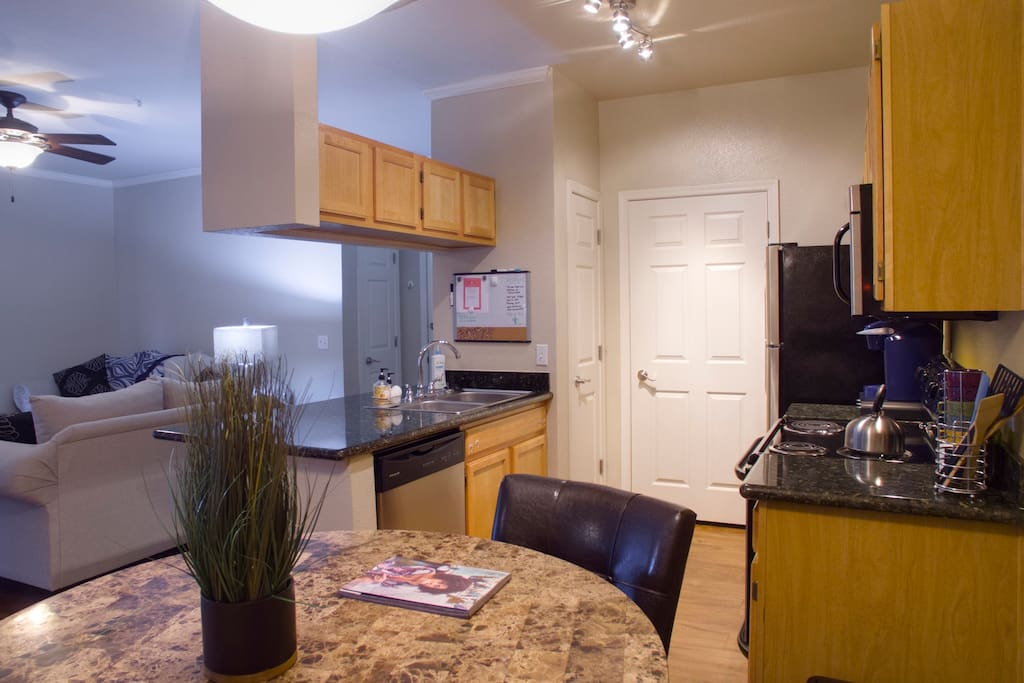 Spacious, open kitchen with interior laundry.