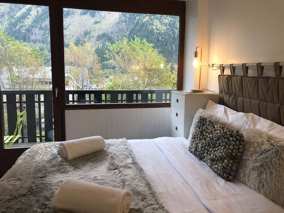 Spacious and bright master bedroom with access to large balcony
