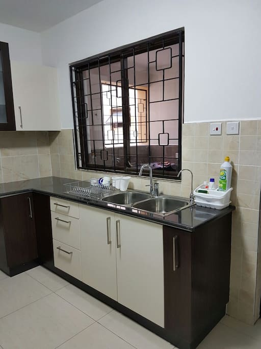 Highly functional fully equipped modular kitchen with adequate storage space